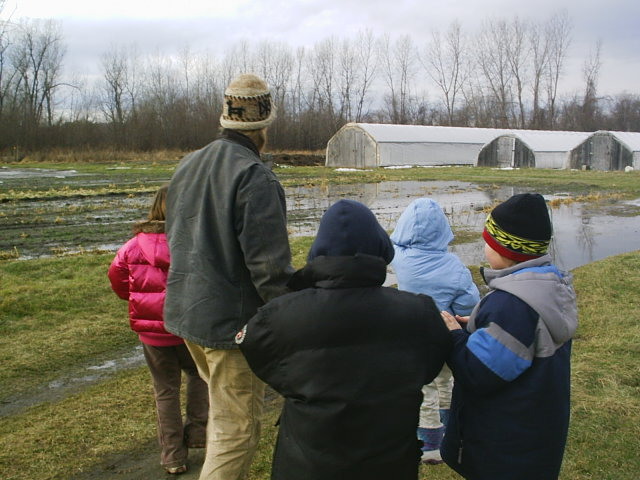 Teacher and students in wet field